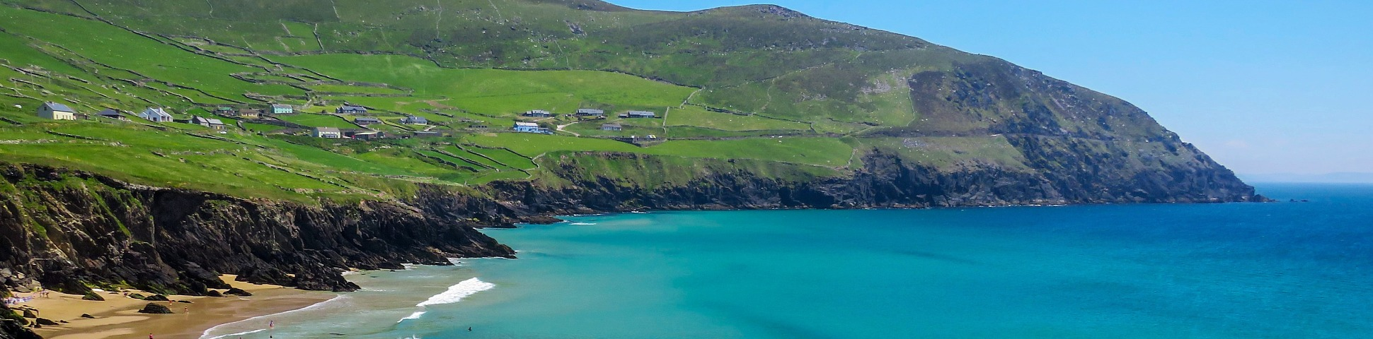 Green hills and blue ocean on the coastline of Kerry in Ireland
