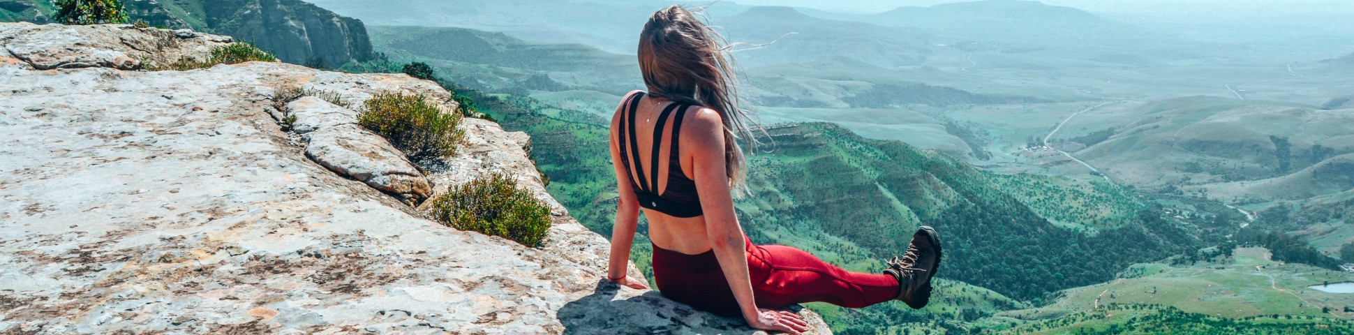Girl sitting at the cliff in Drakensberg Mountains