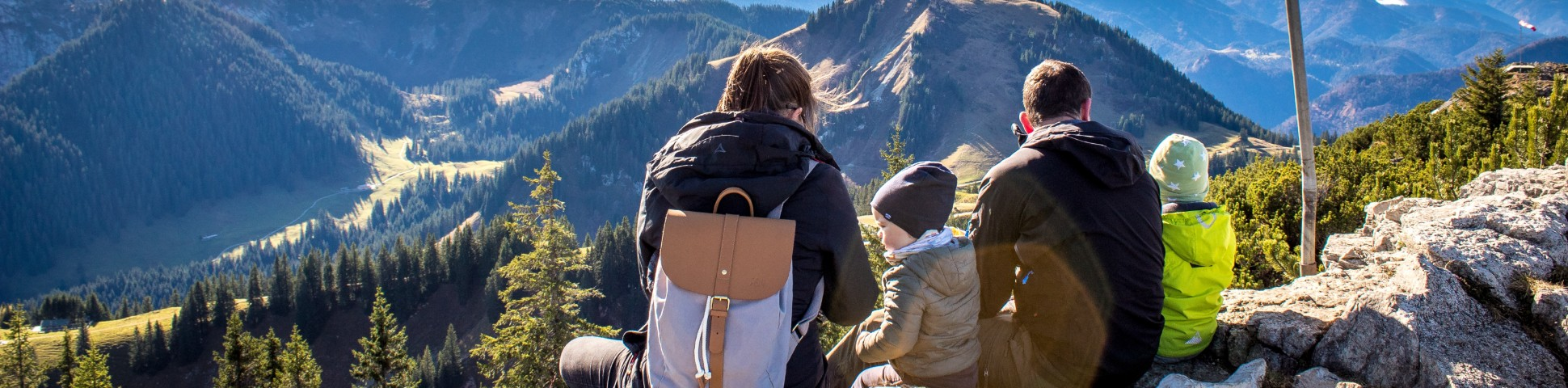Parents with two children hiking in the mountains