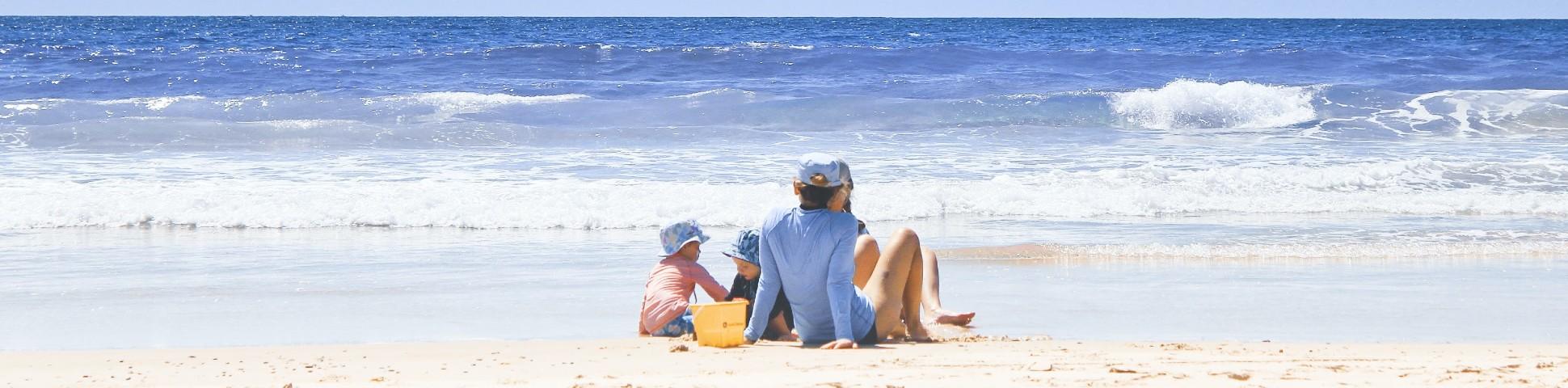 Family enjoying the sunny weather near the beach