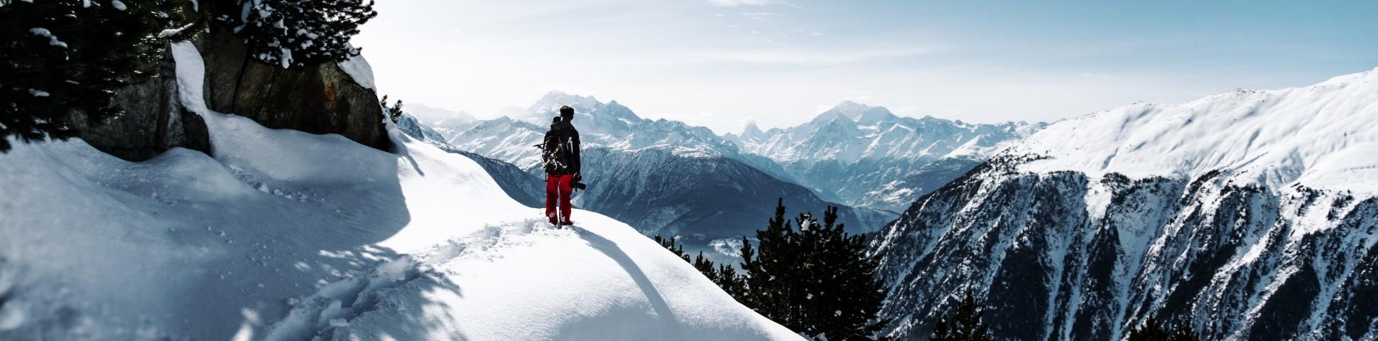 Hiker walking on powdery snow