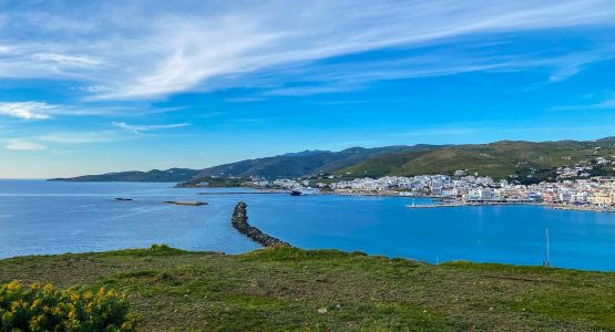 Blue sky over the cove and small village at Tinos island