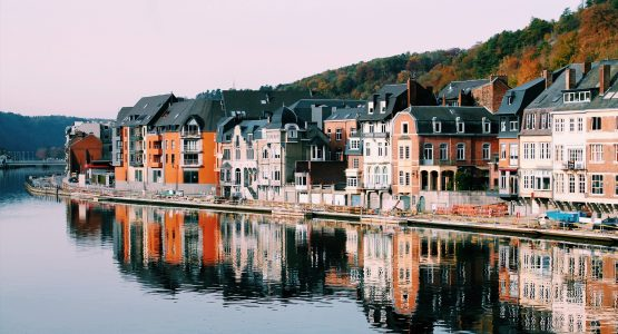 Colorful buildings along the river in Belgium