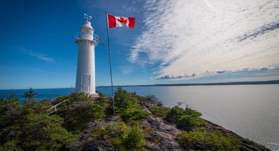 Flag near the lighthouse in Newfoundland