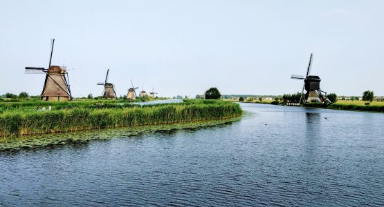 Windmills along the channel in Netherlands
