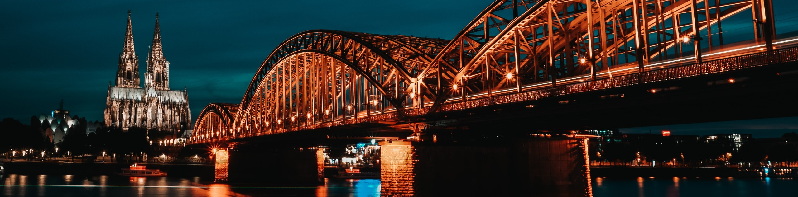 Night lights over the Rhone river and the gothic cathedral in North Rhine-Westphalia