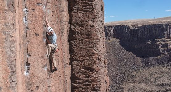 Climbing in red rock valley