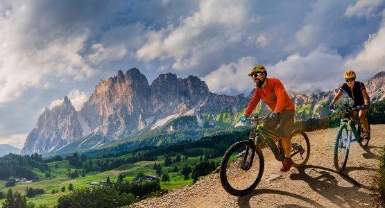 Two bikers e-bike riding in the Italian mountains