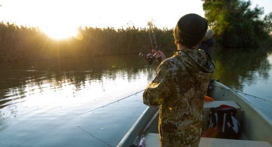 Boy fishing in a lake