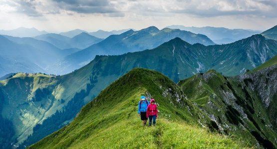 Two hikers walking on a ridge