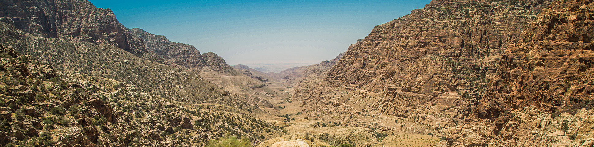 Panoramic view from expansive valley on guided trek from Dana to Petra in Jordan