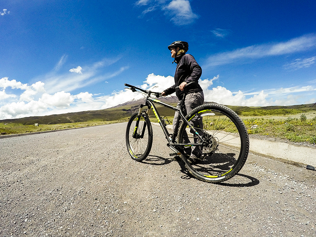 Biker on the road of Cross Country Cycling in Ecuadorian Andes
