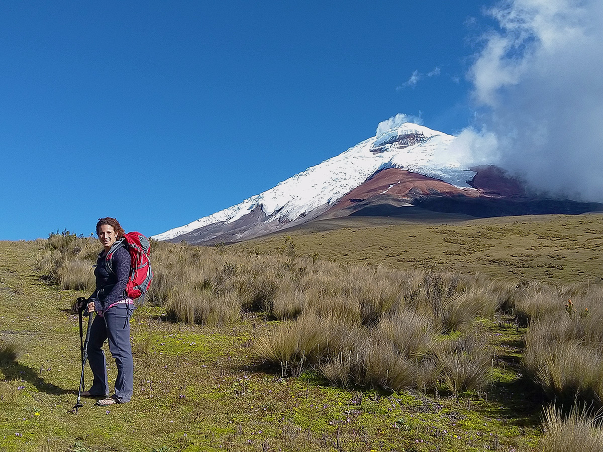 Hiker and the beautiful view on trekking tour in Ecuador in the Avenue of Volcanoes