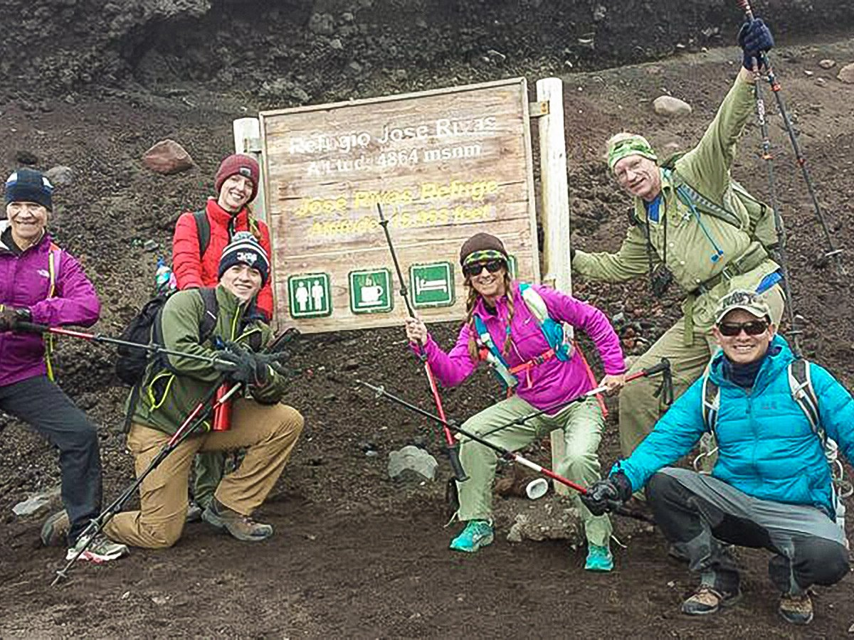 Trekkers near Jose Rivas Refuge on trekking tour in Ecuador in the Avenue of Volcanoes