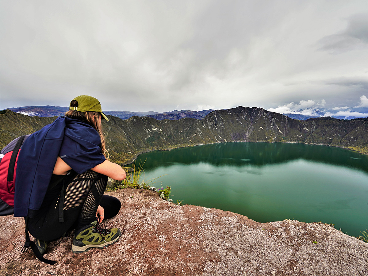 Hiker on trekking tour in Ecuador in the Avenue of Volcanoes