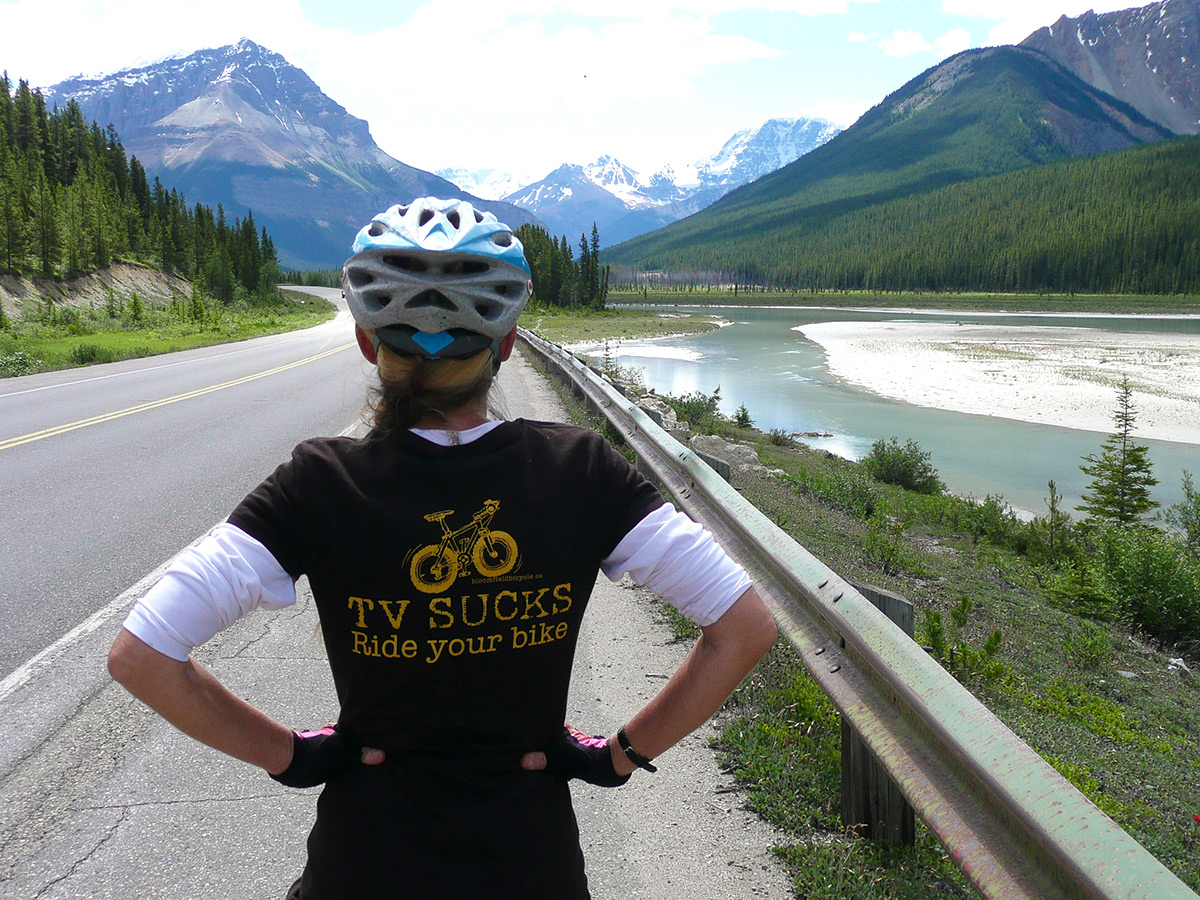 Posing in front of beautiful valley on guided cycling tour from Jasper to Banff in Canada
