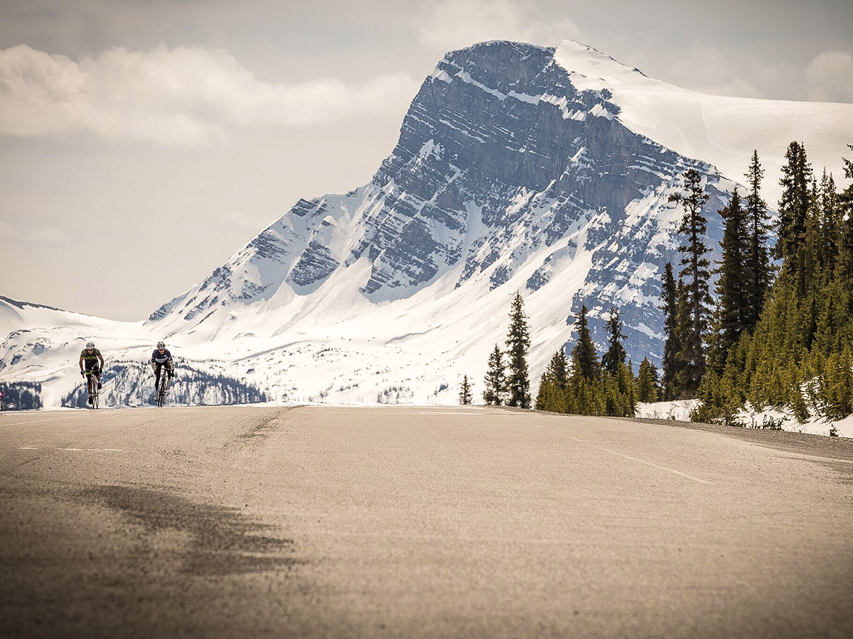 Two bikers on guided cycling tour from Jasper to Banff in Canada