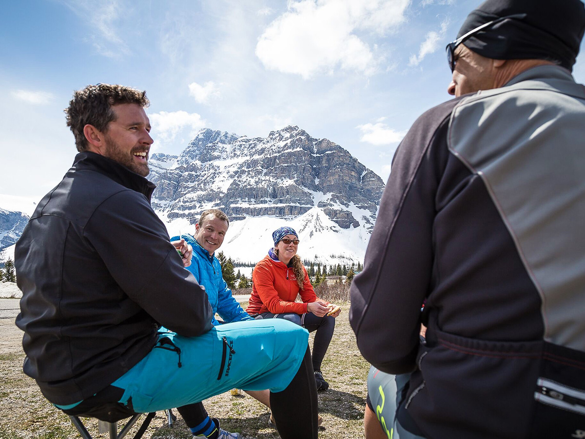 Bikers resting near Icefields Parkway on guided cycling tour from Jasper to Banff in Canada