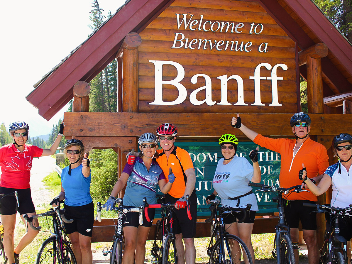 Group of bikers entering Banff on guided cycling tour from Jasper to Banff in Canada