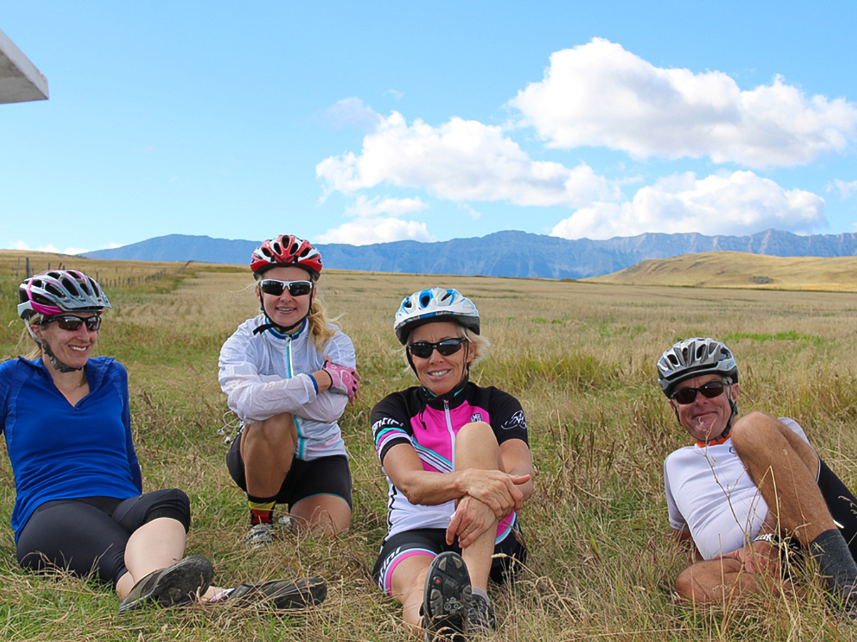 Happy bikers resting on guided cycling tour from Jasper to Banff in Canada