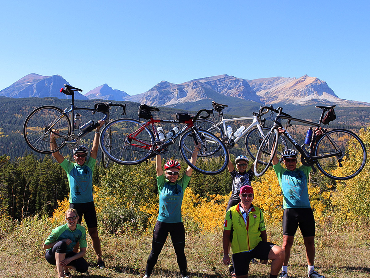 Happy bikers on guided cycling tour from Jasper to Banff in Canada