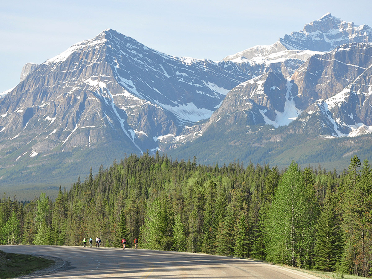 Riding among the beautiful mountains on guided cycling tour from Jasper to Banff in Canada