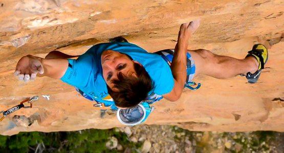 Climber on a steep rock wall