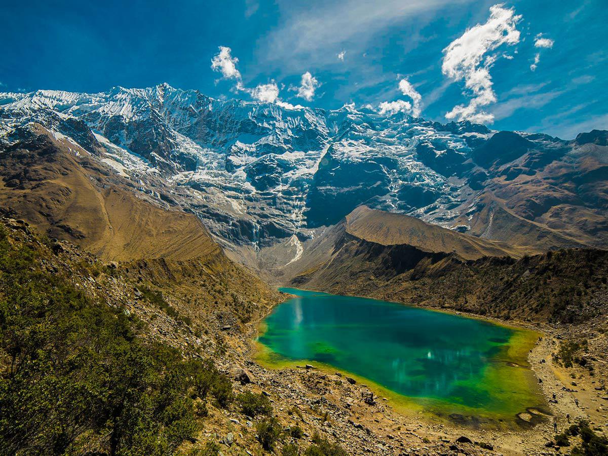 Turquoise lake glaciers and beautiful mountains on Salkantay Trek to Machu Picchu in Peru