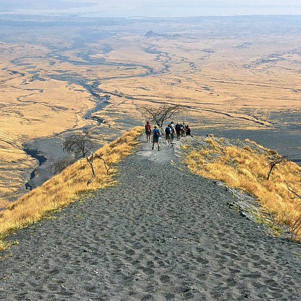 Hiking through desert wastelands on Kilimanjaro trek on Machame Route in Tanzania