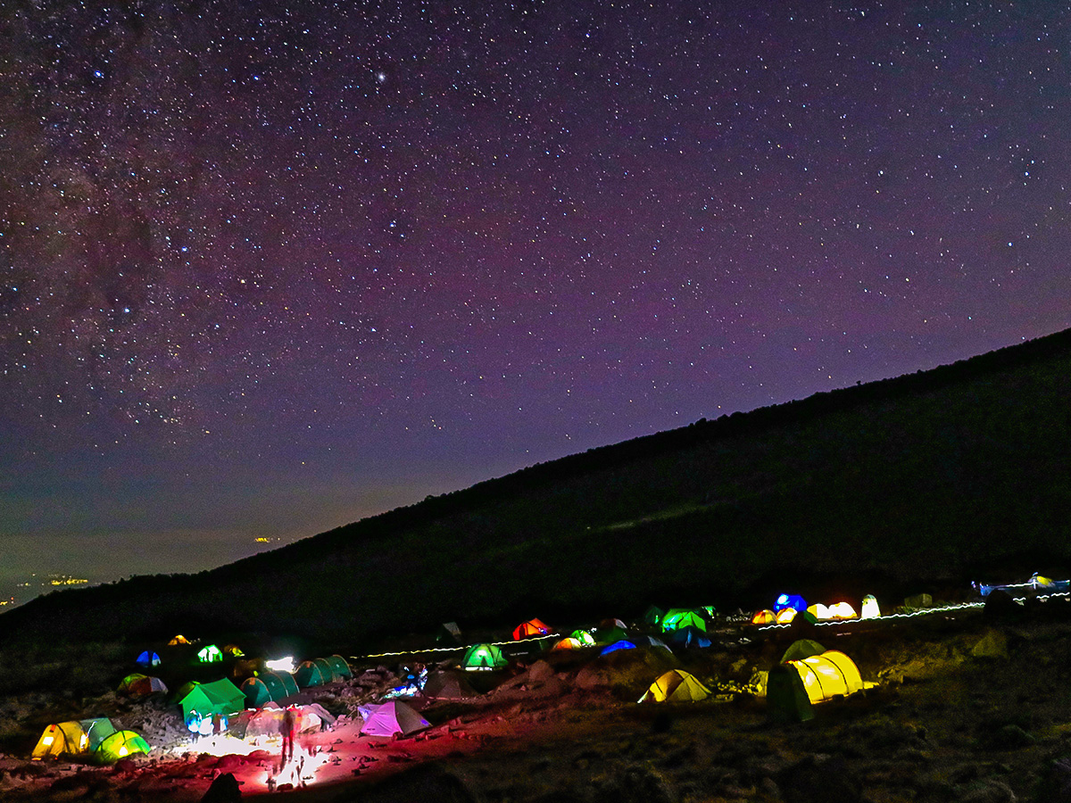 Tents under the starry sky on Kilimanjaro trek on Machame Route in Tanzania
