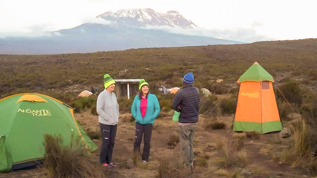 Group of happy hikers on Kilimanjaro trek on Machame Route in Tanzania