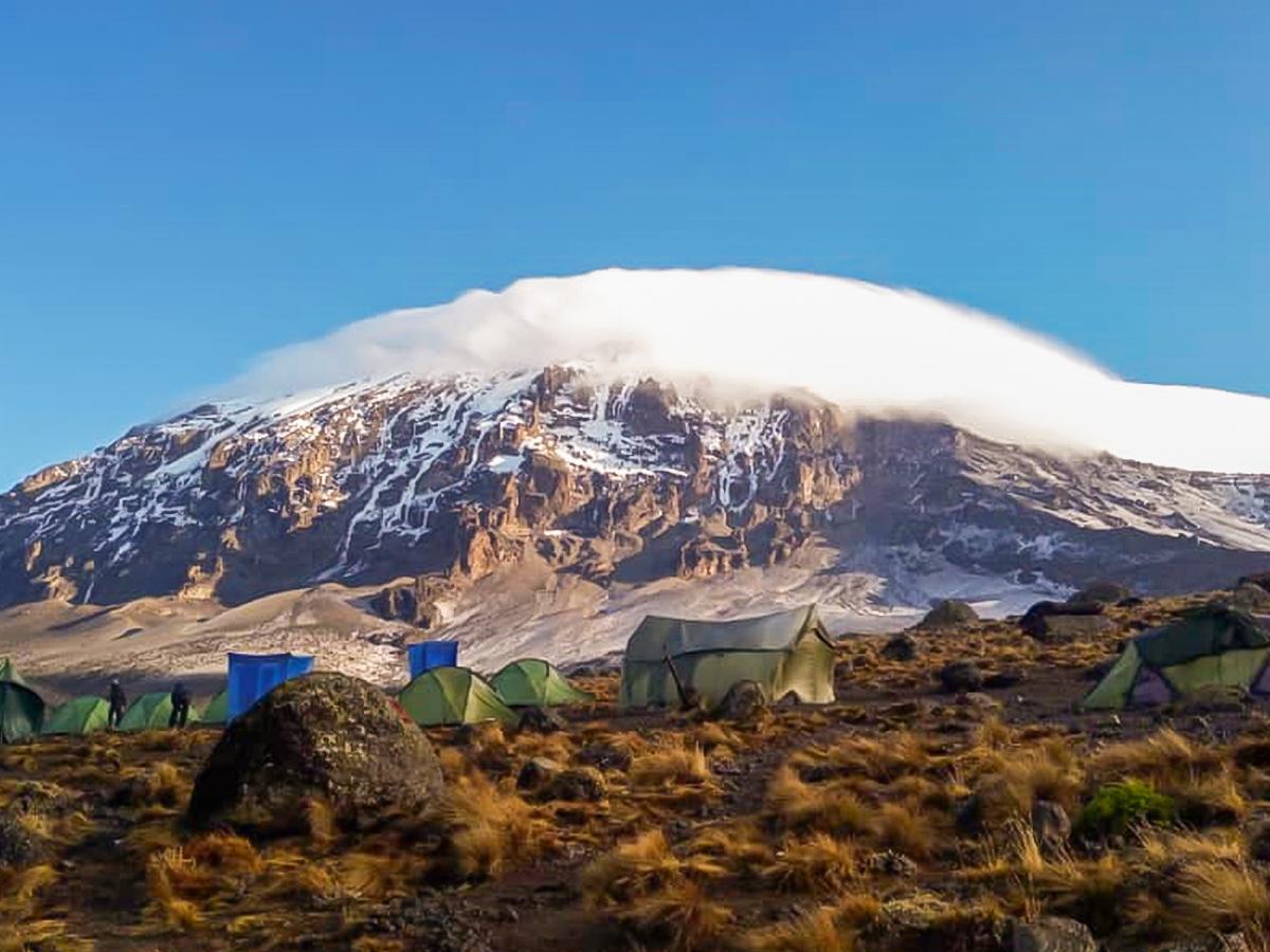 Tents in front of Kilimanjaro on Kilimanjaro trek on Machame Route in Tanzania