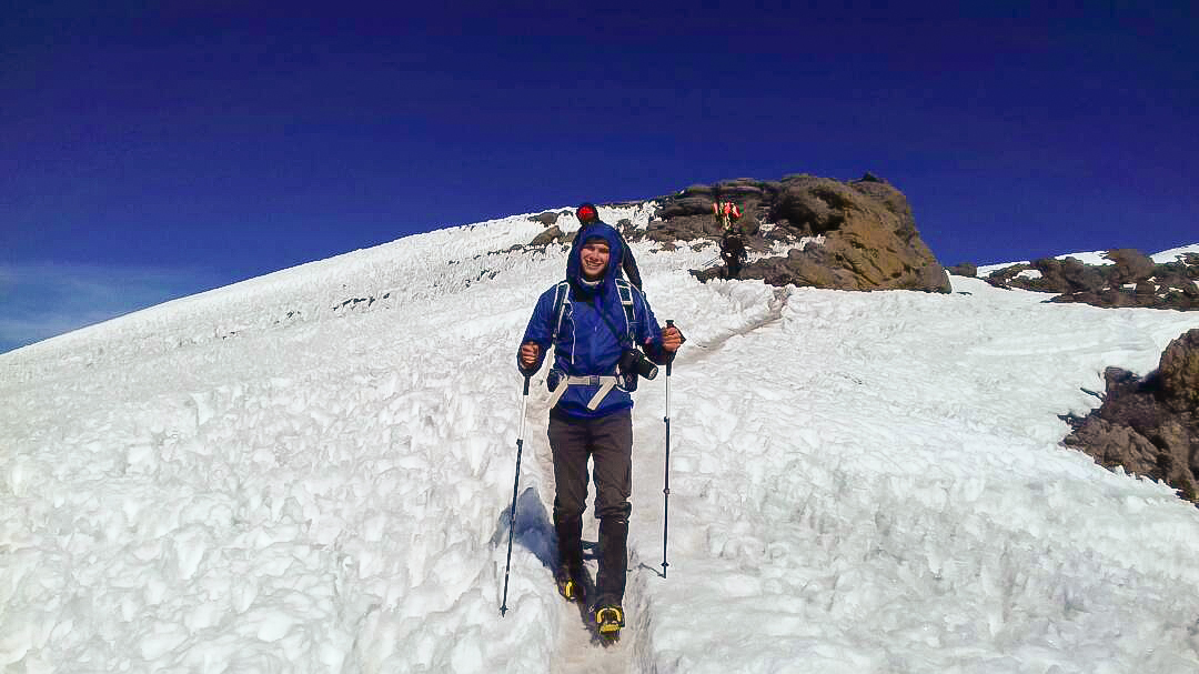 Hiker coming down off of Mount Kilimanjaro on Kilimanjaro trek on Machame Route in Tanzania