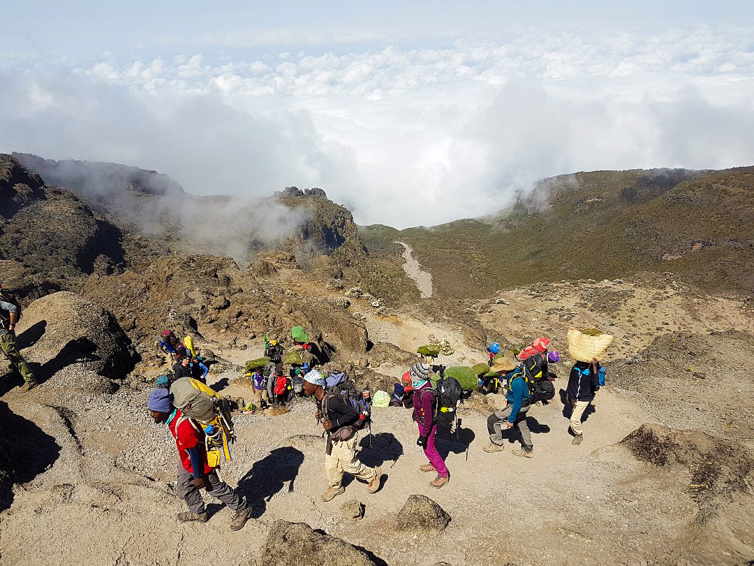 Group of hikers on Kilimanjaro trek on Machame Route in Tanzania