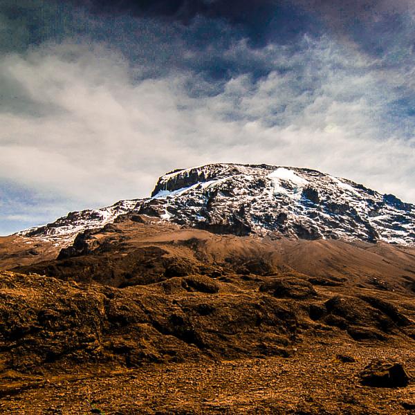 Slowly approaching the summit of Kilimanjaro trek on Machame Route in Tanzania