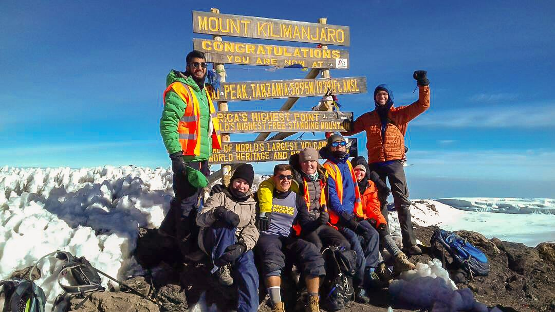 Happy climbers who have reached the top of Kilimanjaro trek on Machame Route in Tanzania