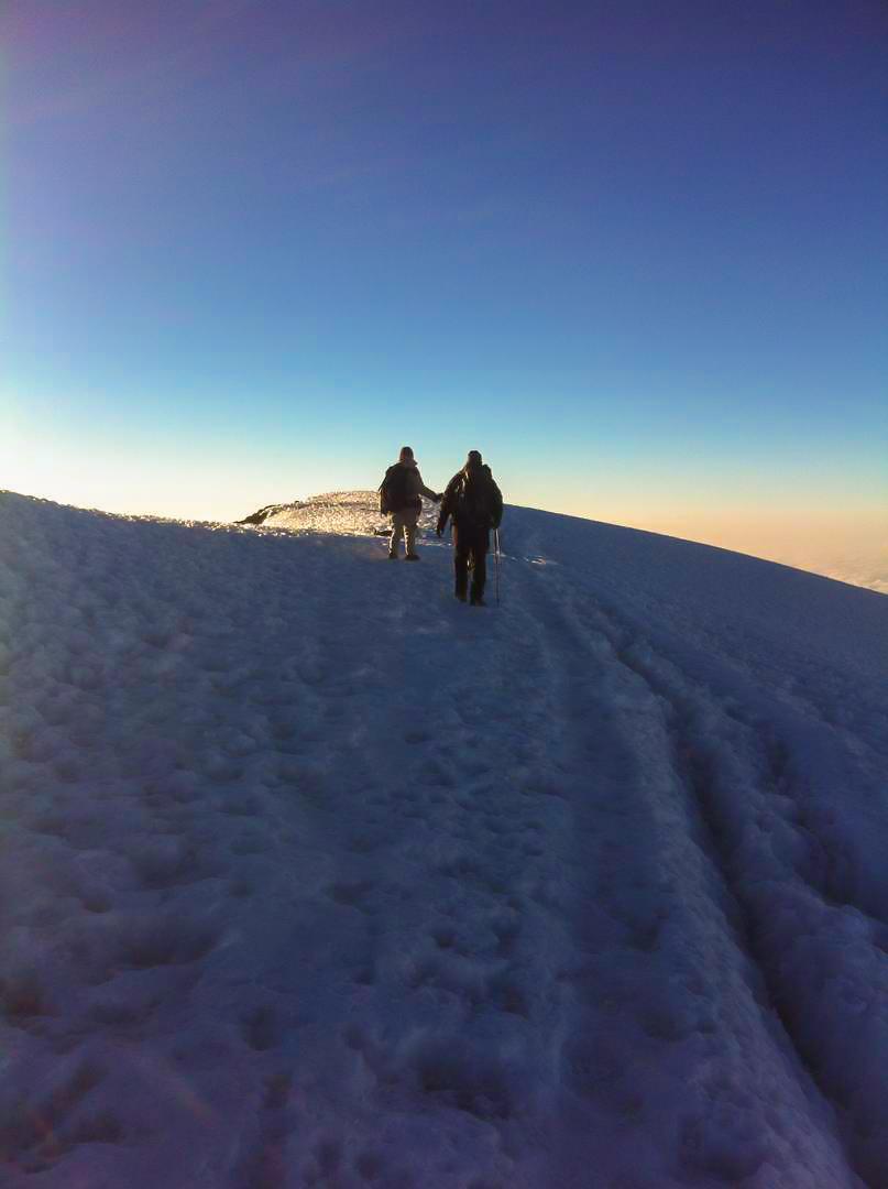 Trekking on snow on Kilimanjaro trek on Machame Route in Tanzania