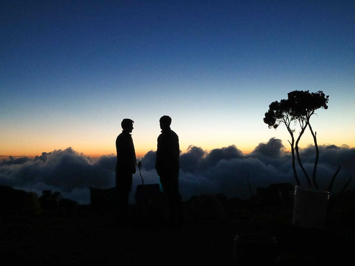 Two hikers on guided Mount Meru trek in Tanzania