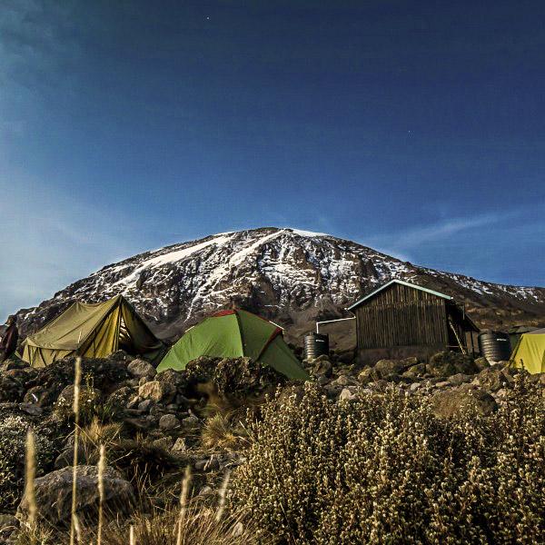 Snowy campgrounds on Kilimanjaro trek on Lemosho Route in Tanzania