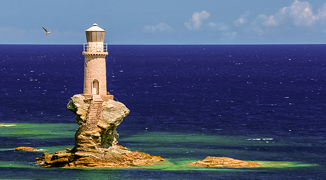 Lonely lighthouse on Authentic Greek Islands hiking tour on Andros & Tinos