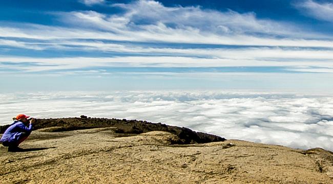 Hiker taking pictures on Kilimanjaro trek on Lemosho Route in Tanzania