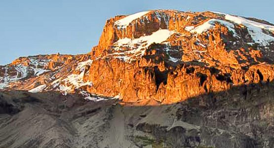 Peak of mount Kilimanjaro covered by sun on guided Kilimanjaro trek on Lemosho Route in Tanzania