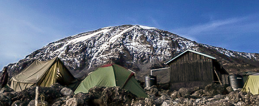 Tents in front of the peak on guided Kilimanjaro trek on Lemosho Route in Tanzania