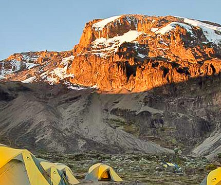 Beautiful peak under the sun on trek to Mount Kilimanjaro on Lemosho route with guide