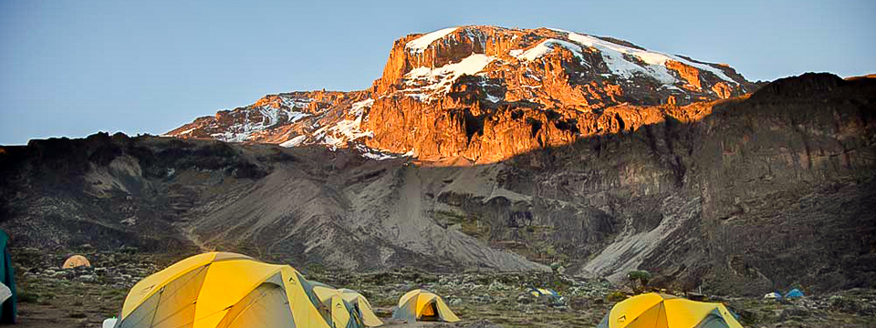 Beautiful peak under the sun on trek to Mount Kilimanjaro on Lemosho route with guide