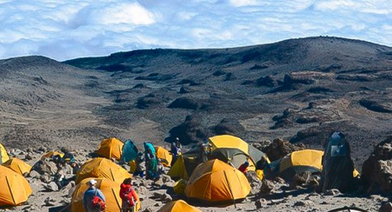 Panoramic view of campsite of Kilimanjaro trek on Machame Route in Tanzania