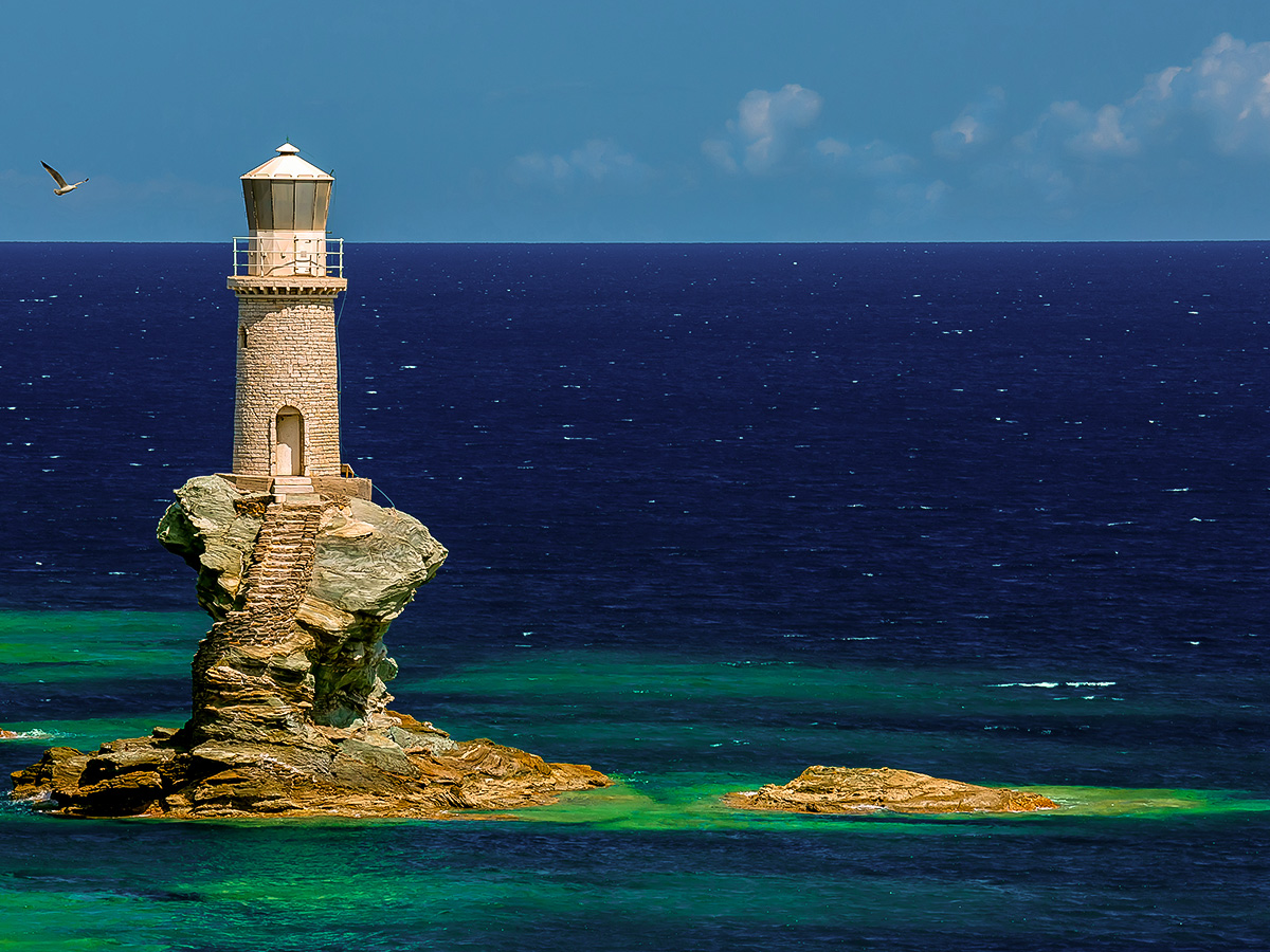 Beautiful lighthouse on Authentic Greek Islands hiking tour on Andros & Tinos