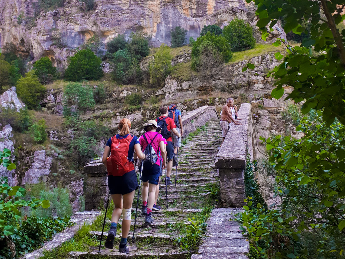 Old stone staircase on tour near Vikos Gorge on Pindos Mountains trail in Greece