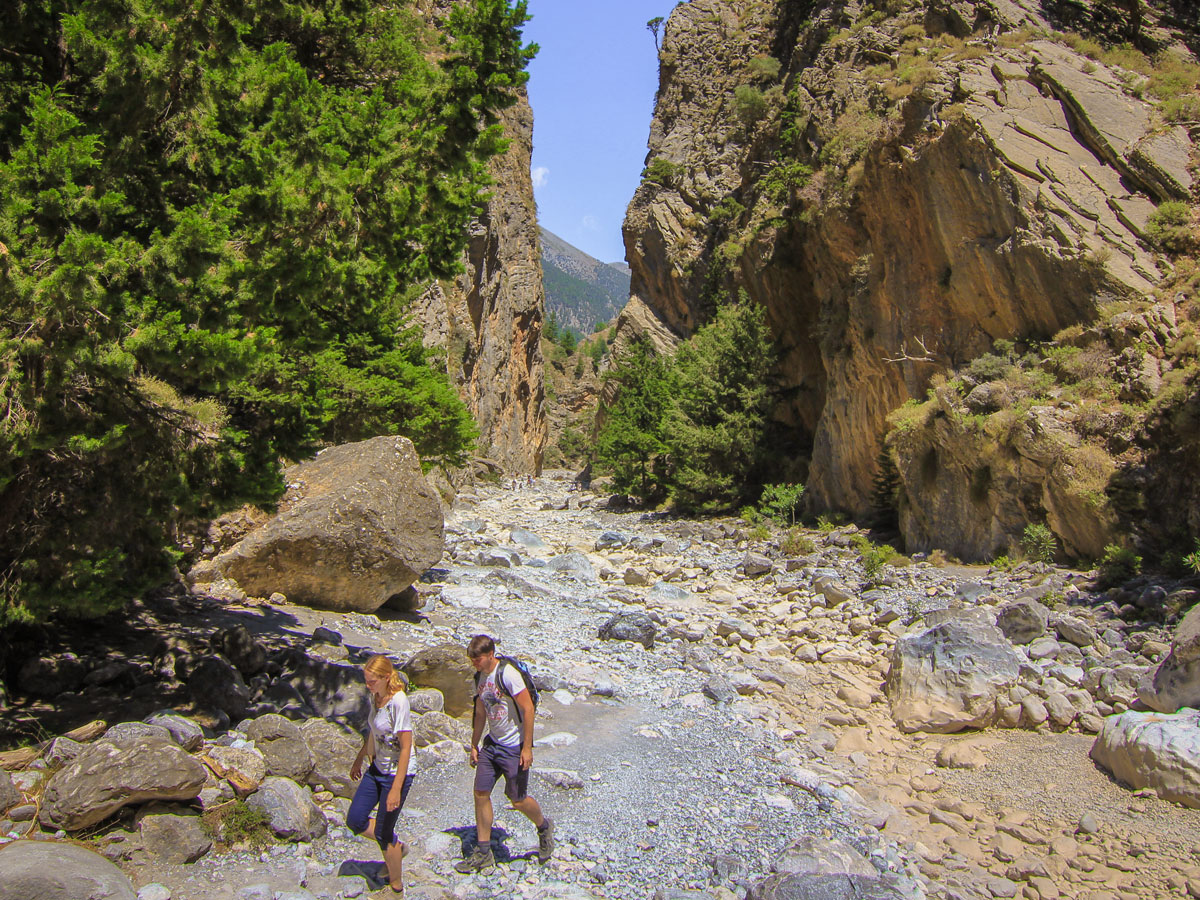 Walking through the gorge on guided trek in the White Mountains of Crete, Greece