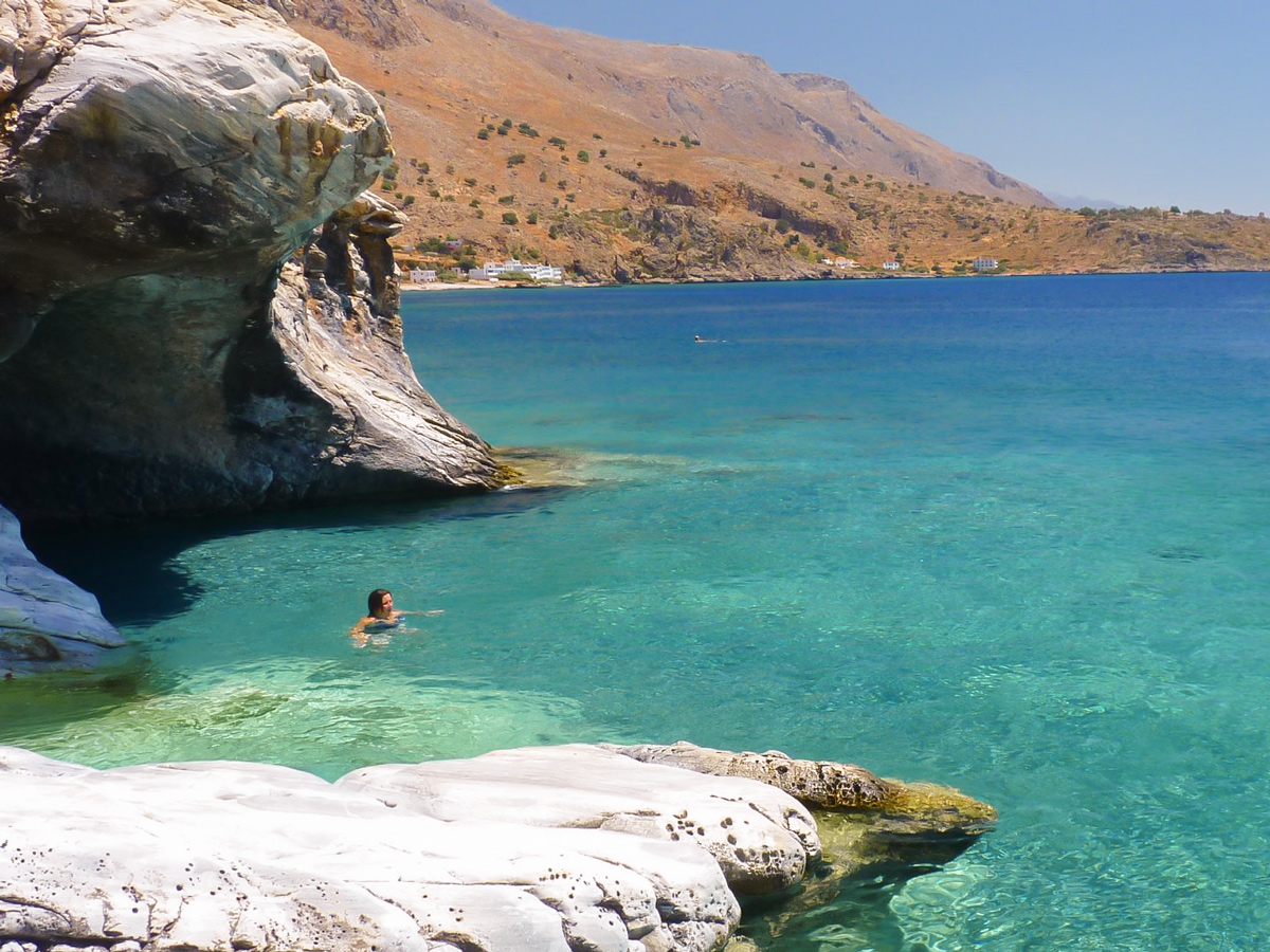 Swimming in the sea on guided trek in the White Mountains of Crete, Greece